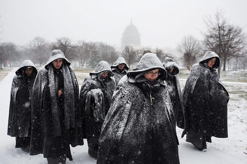 Workers clearing snow from the steps of the US Capitol Building in Washington, DC. The blizzard is expected to cause more than US$1 billion (S$1.44 billion) in damage, officials said.