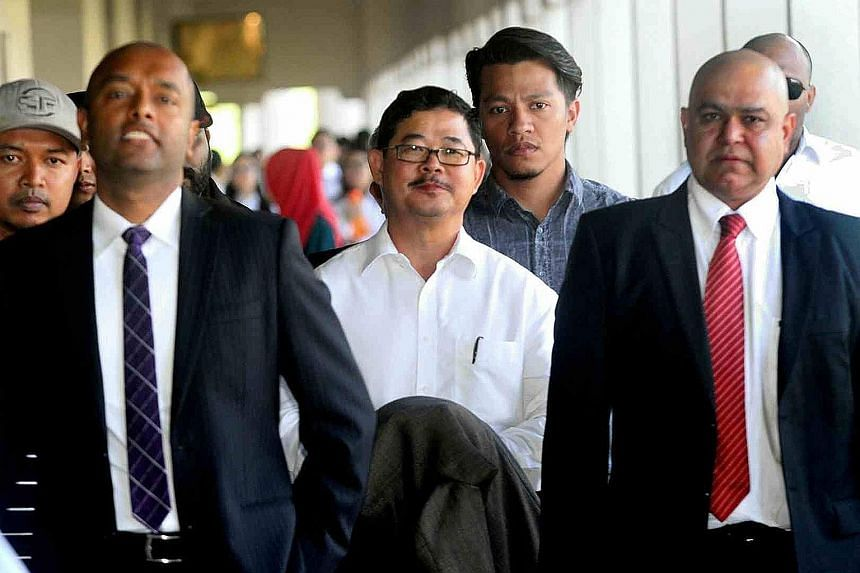 """Ku (centre) allegedly failed to declare profits from a """"commission"""" in a sworn statement dated Jan 8, 2014."""