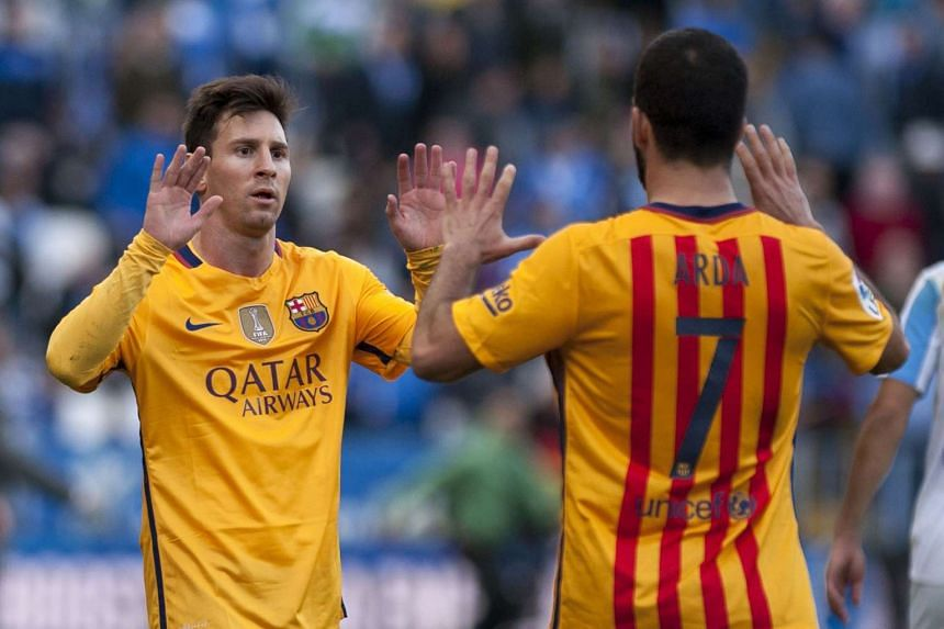 Messi (left) celebrates with Turkish midfielder Arda Turan after the 1-2 win.
