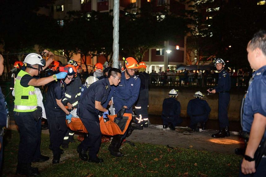 SCDF officers carrying one of the victims from the scene of the accident, on Jan 24, 2016.