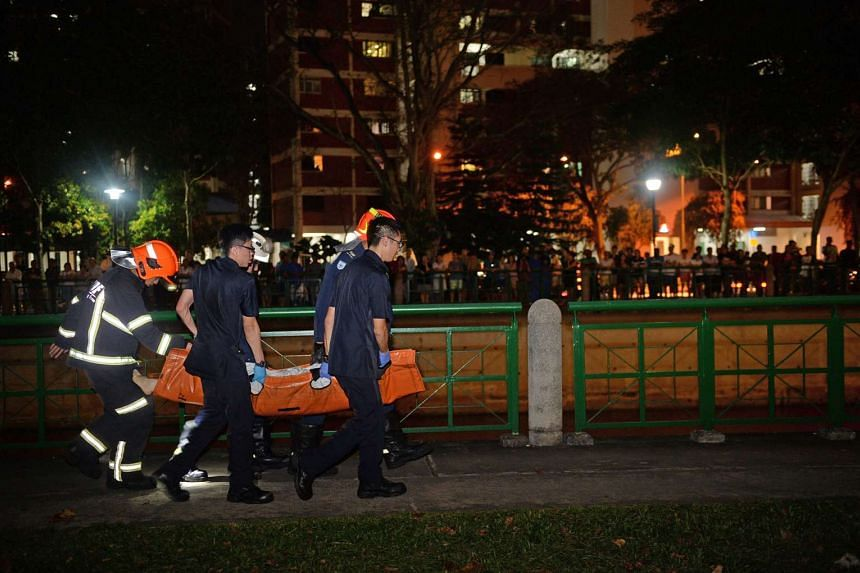 SCDF officers carrying one of the victims of the accident on Jan 24, 2016.