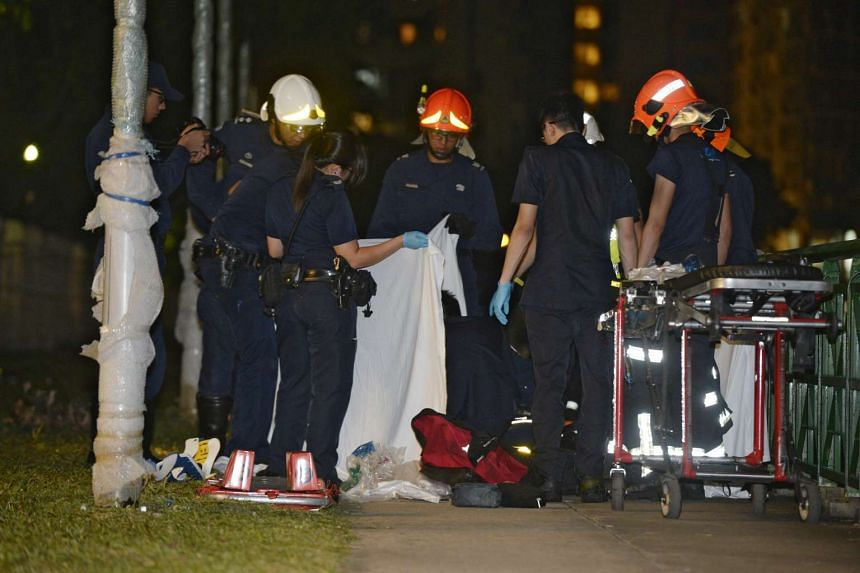 SCDF officers attending to one of the victims of the accident, near Valley Point Shopping Centre, on Jan 24, 2016.