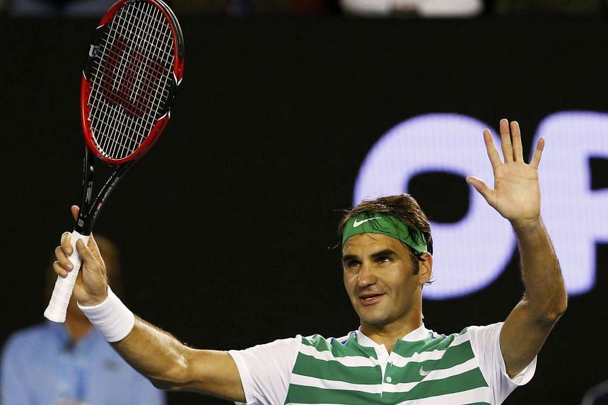 Switzerland's Roger Federer celebrates after winning his fourth round match against Belgium's David Goffin at the Australian Open on Sunday.