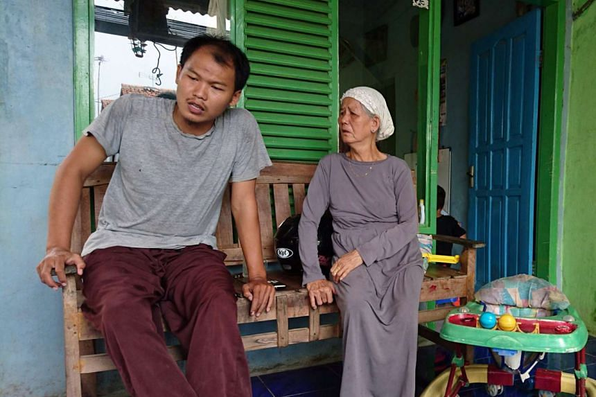 Sulaiman, the younger brother of Sunakim, with their grandmother Sumani at their home in Desa Kalensari. Sulaiman said his brother stayed with them from Dec 23 until Jan 2.