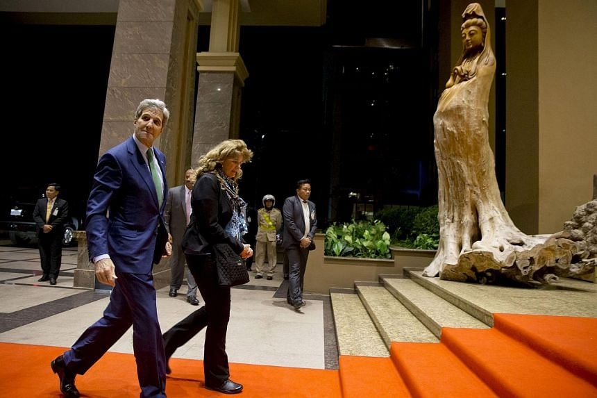 US Secretary of State John Kerry (left) walks into the Landmark Hotel upon arrival in Vientiane, Laos, on Jan 24, 2016.