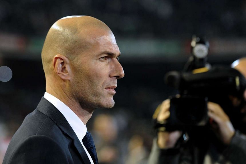 Zinedine Zidane looks on during the Spanish league football match between Real Betis and Real Madrid.