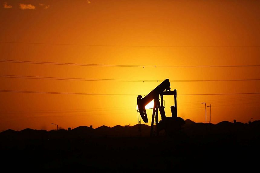 A pumpjack sits on the outskirts of town at dawn in the Permian Basin oil field on Jan 21, 2016, in the oil town of Midland, Texas.