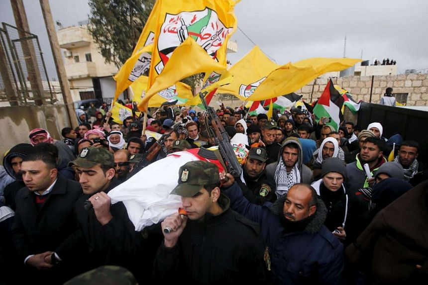 Members of Palestinian security forces carry the body of Palestinian girl Ruqayya Abu Eid, 13, during her funeral in the West Bank town of Yatta, south of Hebron, on Jan 24, 2016.