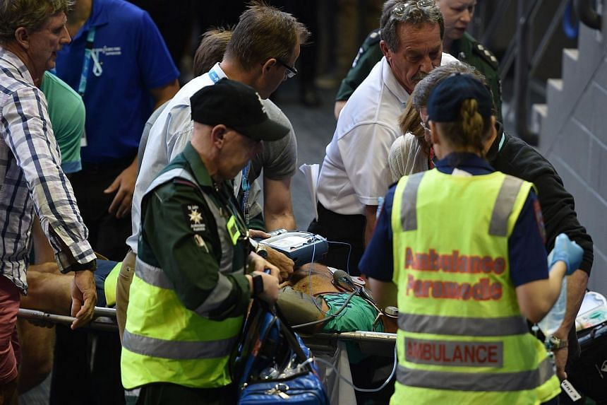 Medical staff use a stretcher to carry Nigel Sears from the stadium at the Australian Open tennis tournament in Melbourne on Jan 23, 2016.