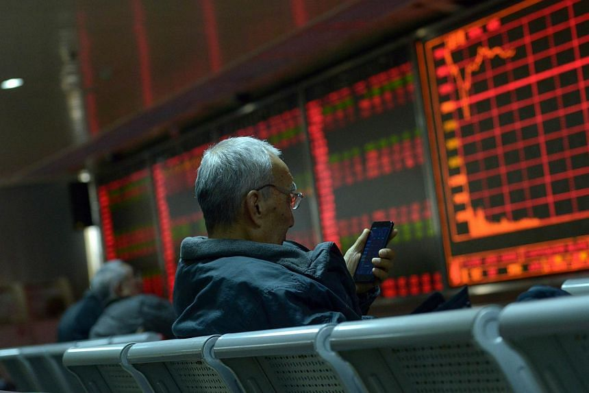 An investor at a securities company in Beijing.