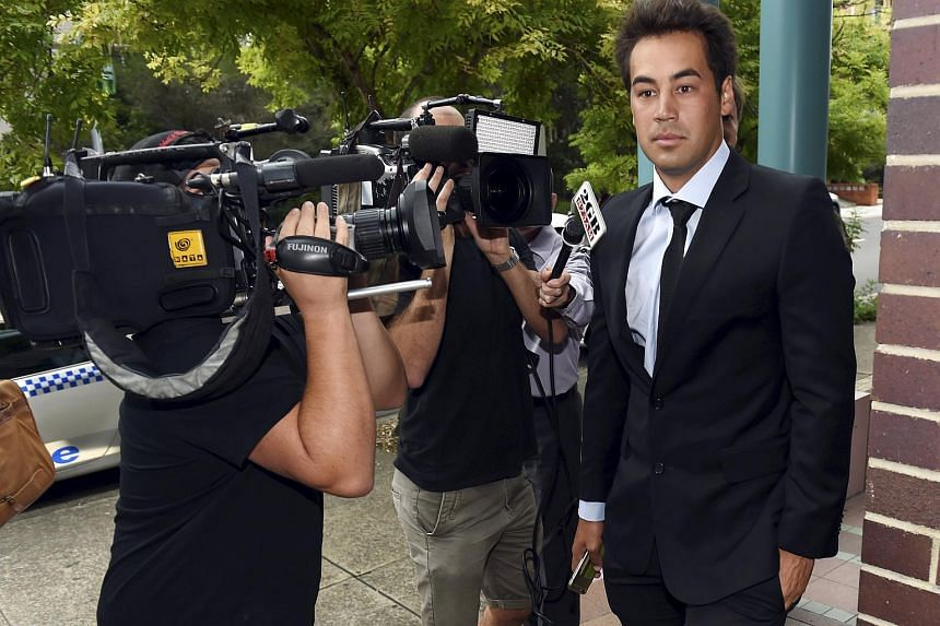Former professional tennis player and coach Nick Lindahl (right) leaves an Australian court after pleading guilty to one charge related to tennis match-fixing on Jan 25, 2016.