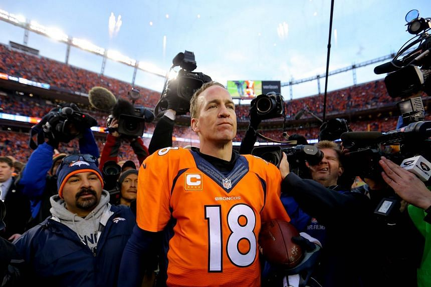 Peyton Manning #18 of the Denver Broncos walks off the field after defeating the New England Patriots in the AFC Championship game.