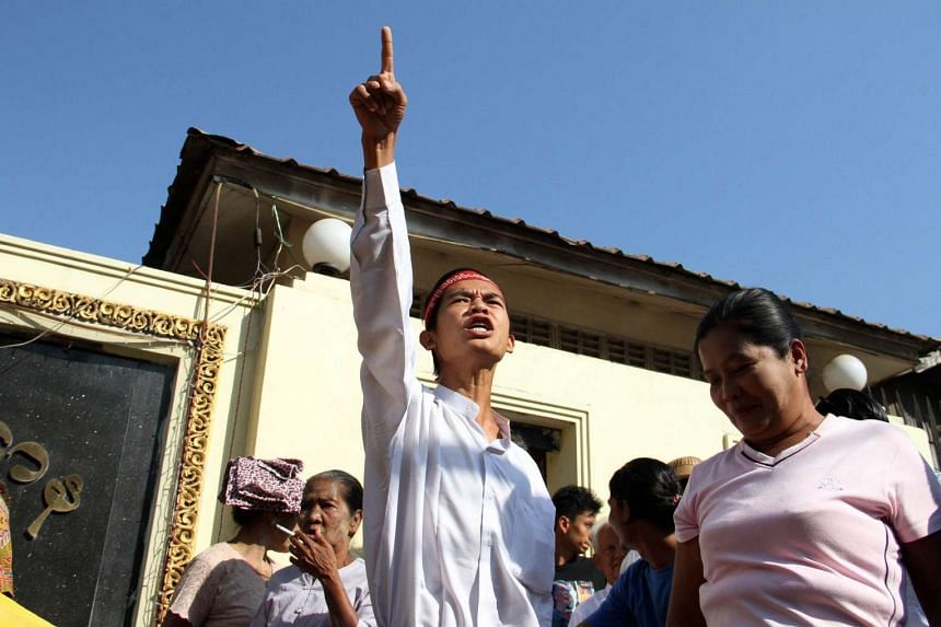 Min Ko Ko (centre), a released political prisoner, shouts in front of Insein prison upon his release from detention in Yangon on Jan 22, 2016.