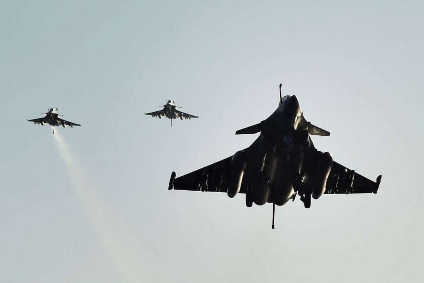French Rafale fighter aircraft landing on the French carrier Charles de Gaulle on Nov 23, 2015.
