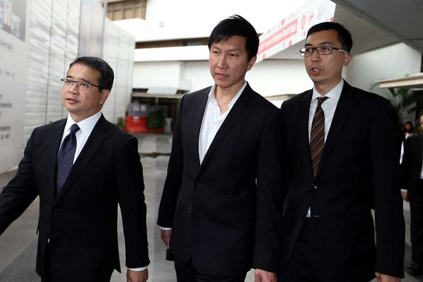 Kong Hee (centre) founder and senior pastor of the City Harvest Church (CHC), leaving the State Courts with his lawyers on Nov 20, 2015.