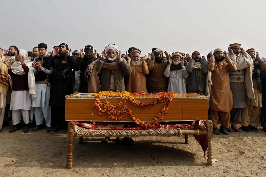 People attend the funeral of Fakhr-e-Alam a worker at Bacha Khan University, who was killed in Taliban attack at the University in Charsadda, Pakistan.