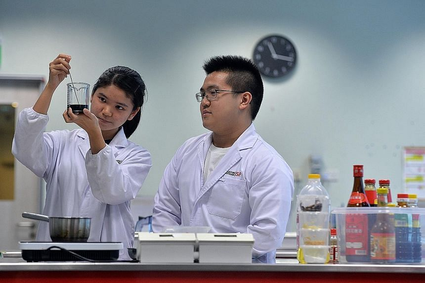 Singapore Polytechnic students Seah Xin Hui and Shaun Koh, who interned at the polytechnic's Food Innovation Resource Centre. From projects that the polytechnic undertakes,the proportion that gets commercialised has grown from around 10 per cent in 2