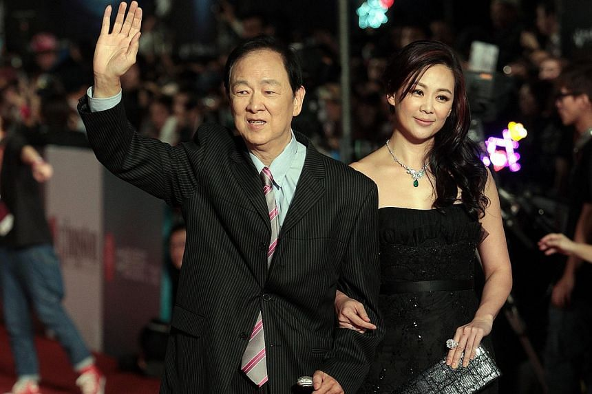 Taiwanese actor Wang Yu and his daughter Linda Wong (both left) arriving at the red carpet of the 50th Golden Horse Awards presentation ceremony in 2013.