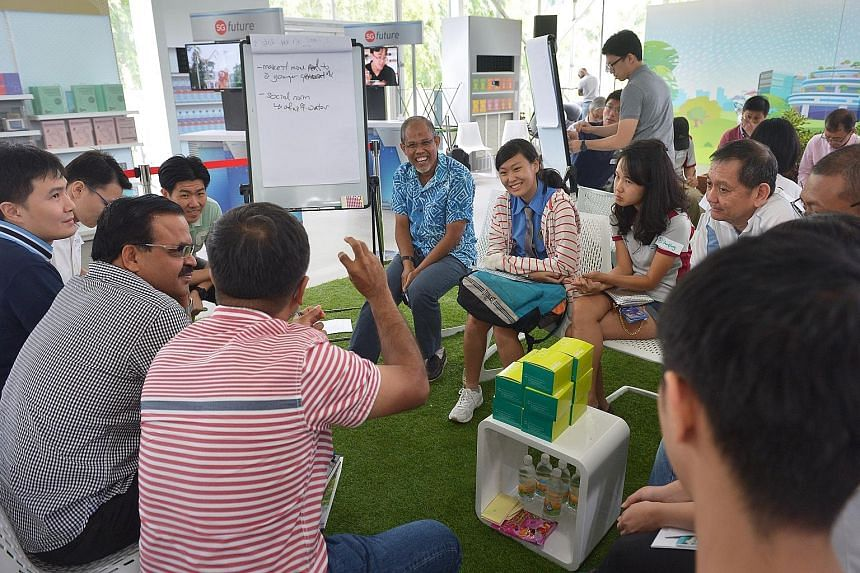 Minister for the Environment and Water Resources Masagos Zulkifli (centre, in blue) attending a focus group session on water at The Future Of Us exhibition at Gardens by the Bay yesterday. Participants gave suggestions on how Singaporeans can be enco