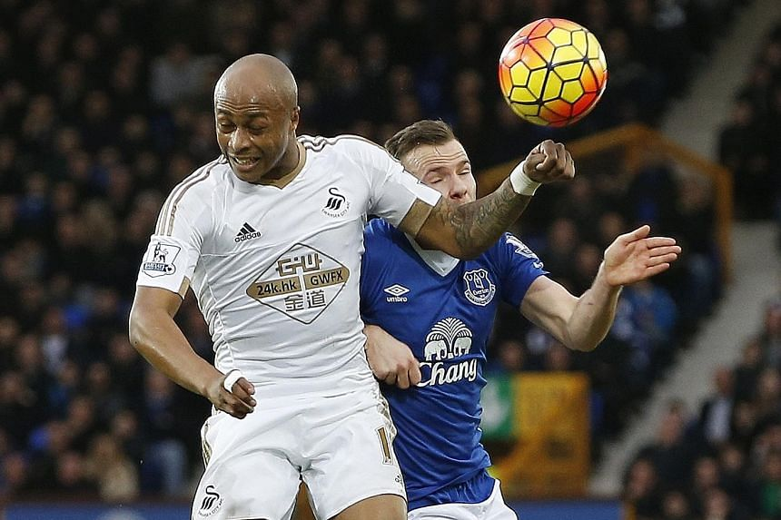 Swansea's Andre Ayew (left) and Everton's Tom Cleverley battling for the ball in their league clash last night. Ayew scored the Swans' winner.