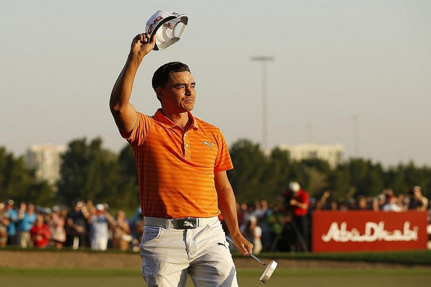 Rickie Fowler smiles after winning the Abu Dhabi HSBC Championship, his fourth title in eight months.