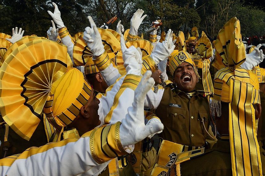 Central Industrial Security Force members dancing as they waited to participate in a full-dress rehearsal for the upcoming Republic Day parade in Kolkata yesterday. French soldiers will march down Rajpath in New Delhi along with Indian troops in the