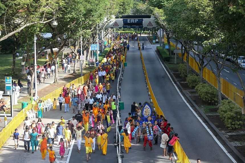 This year's procession included a dedicated lane for female and young devotees in Clemenceau Avenue. It enabled them to enter the Tank Road temple faster and not get stuck in a bottleneck behind kavadi-carrying devotees.