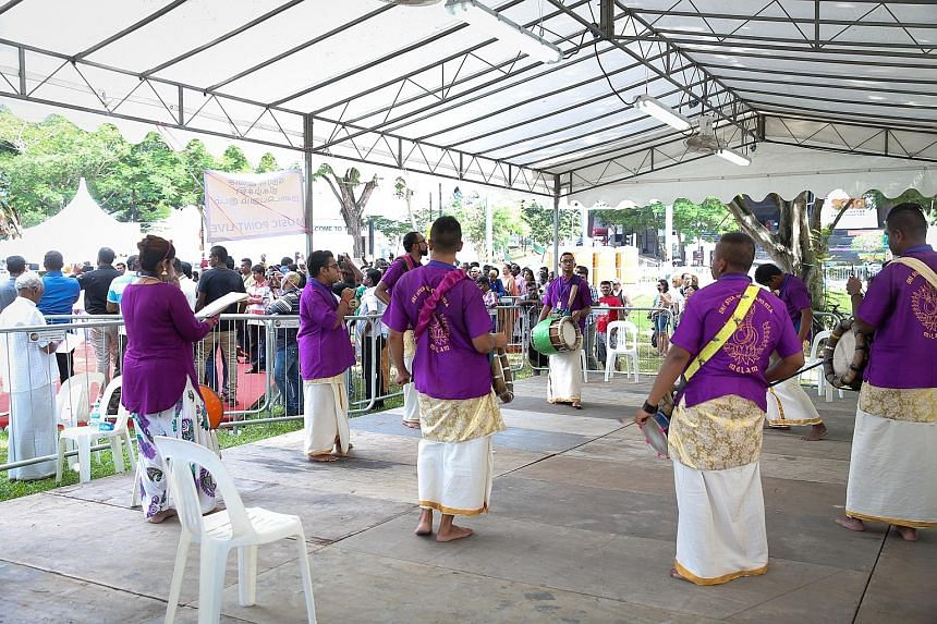 Musicians playing for the kavadi bearers at the live music stage at Dhoby Ghaut Green. For the first time in over 40 years, live music was available along the Thaipusam route withthree live music points,as well as seven transmission music points. Hin