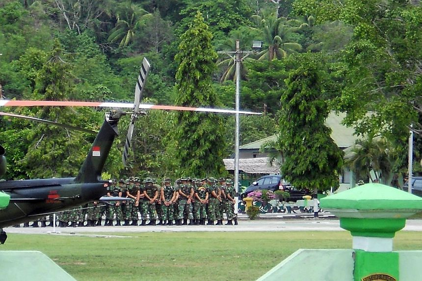 Indonesian troops arriving in Poso, Central Sulawesi, yesterday to join the hunt for Santoso, the leader of the East Indonesia Mujahidin terrorist group. Santoso is believed to be responsible for several attacks on the police in Central Sulawesi over