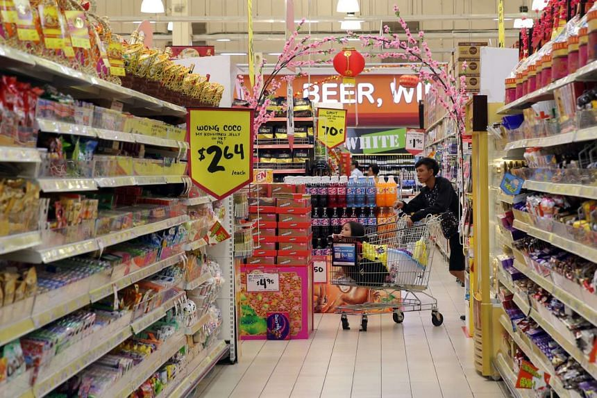A file photo of people shopping at a supermarket in Singapore. PHOTO: SPH