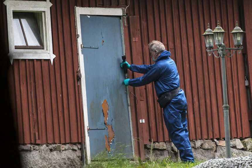 A police technician investigating a bunker where a Swedish doctor is believed to have been holding and sexually abusing a woman, outside Knislinge in southern Sweden, on Sept 22, 2015.