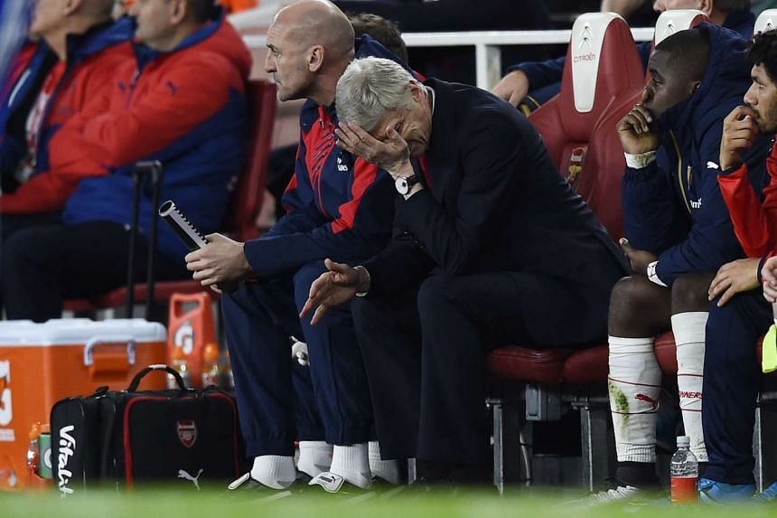 Arsenal manager Arsene Wenger looks dejected after the 0-1 loss to Chelsea on Sunday.