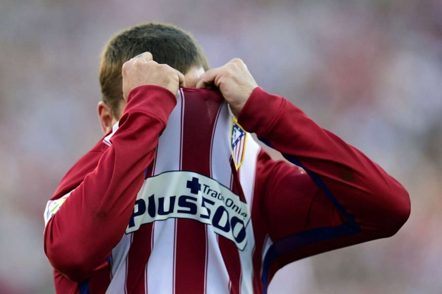 Atletico Madrid's French forward Antoine Griezmann reacts after missing a goal during the match against Club Atletico de Madrid vs Sevilla FC on Sunday.