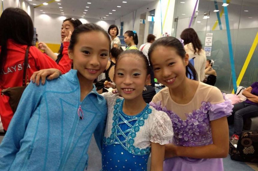 Young (centre) with her Singapore ice- skating friends in a photo taken at JCube ice- skating rink in Jurong East in 2013.
