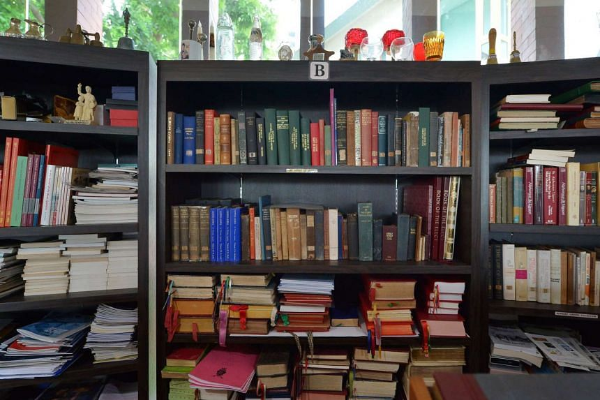Old and rare books are seen here in the church archives. Church artefacts include the original 1935 chronicles of Father Aloysius John Brennan, one of the church's founding priests.