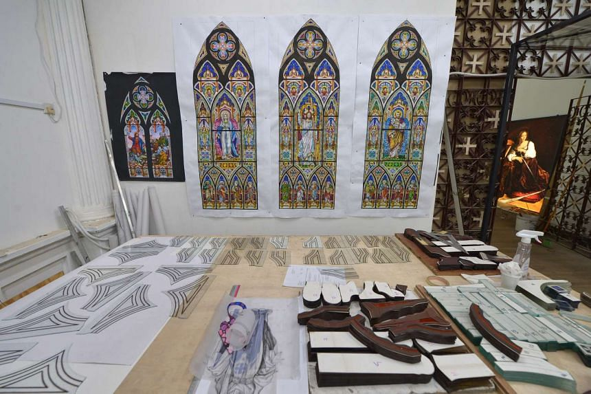 Some of the stained glass designs that have been chosen for the new church extension. As the church has been gazetted by the Urban Redevelopment Authority, the facade of its existing building, which includes a triple arc front pediment, cannot be alt