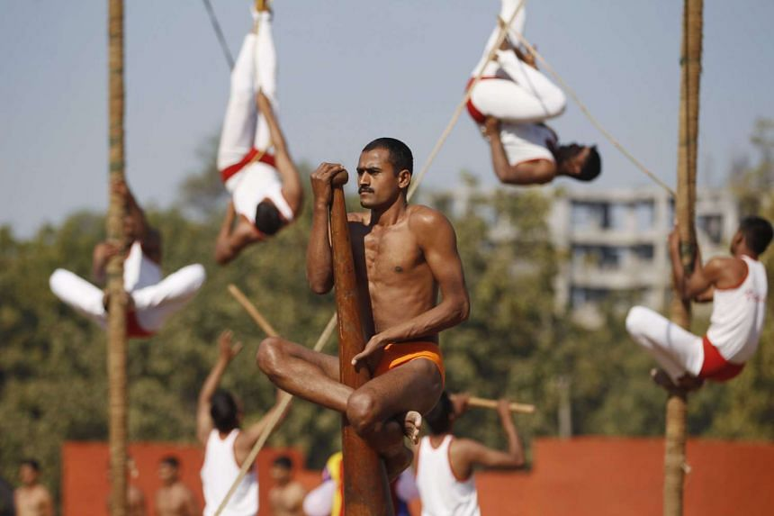 Indian army soldiers perform traditional Indian gymnastics on the eve of India's Republic Day on Jan 25, 2016.
