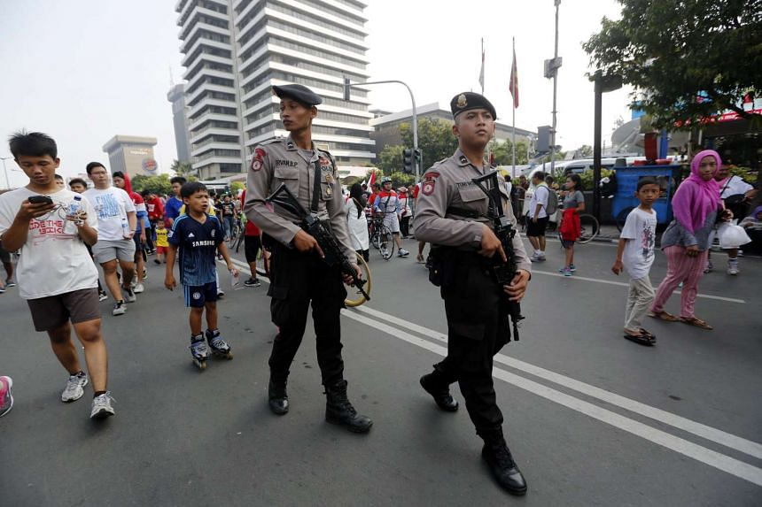 Indonesian Police officers patrol near the site of the Jan 14 terrorist attacks in Jakarta, Indonesia.