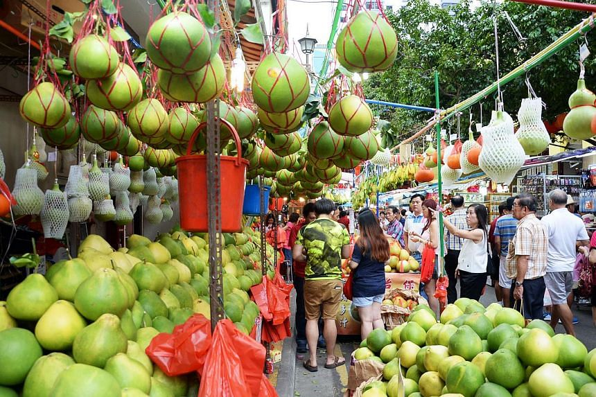 A stall selling pomelos at a Chinese New Year bazaar in Chinatown.