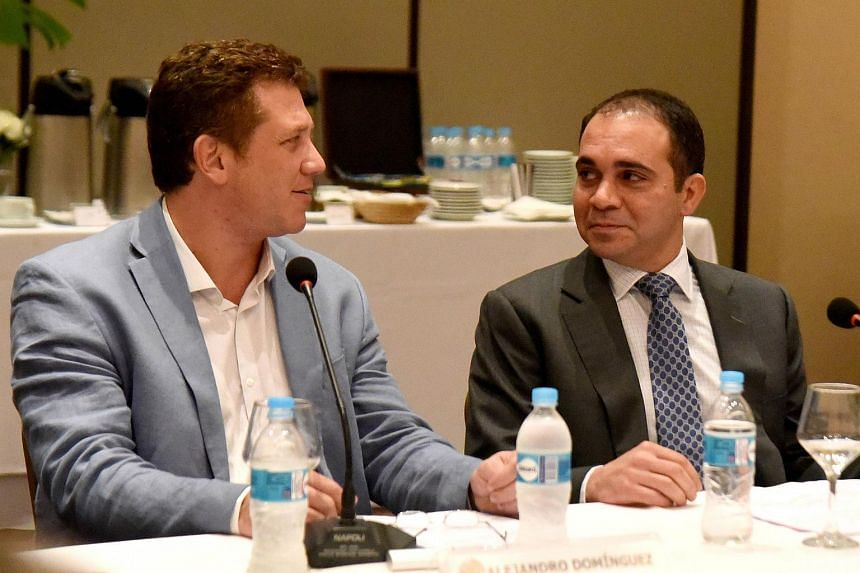 Jordan Prince Ali Bin Al Hussein (right), candidate for Fifa president, talks with AFP president and candidate for president of the CONMEBOL Alejandro Dominguez in Paraguay on Jan 25, 2016.