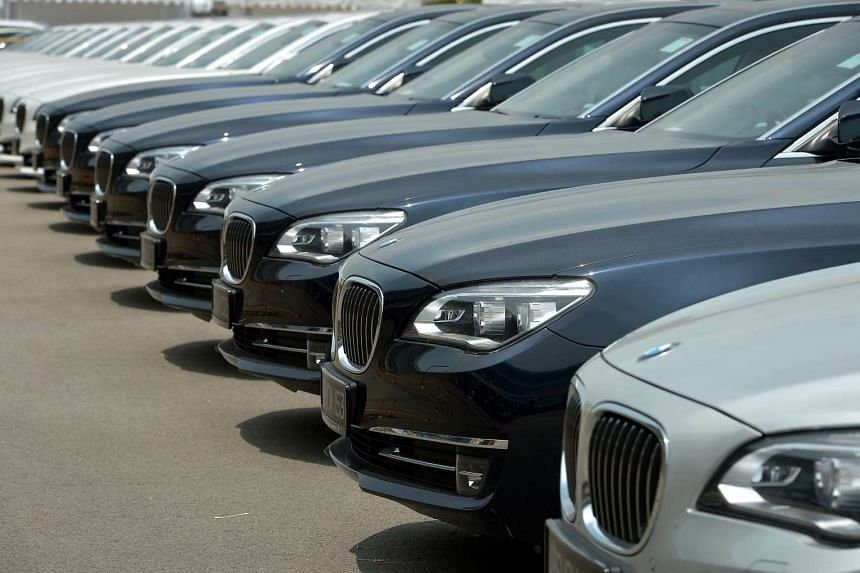 BMW cars parked on the open tarmac in front of the Changi Exhibition Centre during the Singapore Airshow 2014.