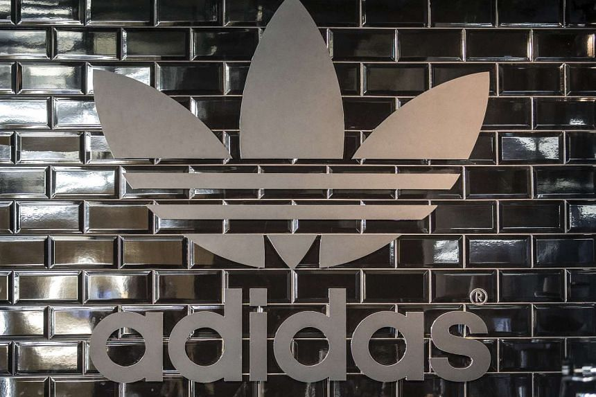 The Adidas logo is pictured in a pop-up store in Berlin on Dec 2, 2014.