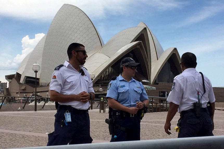 Police officers and security staff standing outside the Sydney Opera House on Jan 14, 2016.