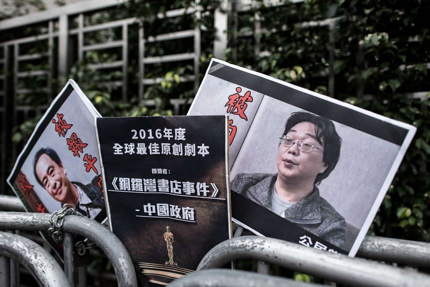 Placards showing a missing bookseller and his associate outside  the China liaison office in Hong Kong on Jan 19, 2016.