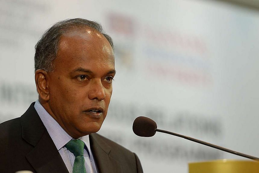 Mr K. Shanmugam, Minister for Home Affairs & Law, speaking at an inter-religious symposium at Marina Mandarin Hotel on Jan 19, 2016.
