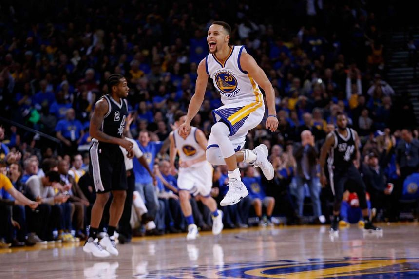 Stephen Curry of the Golden State Warriors celebrates after he makes a shot.