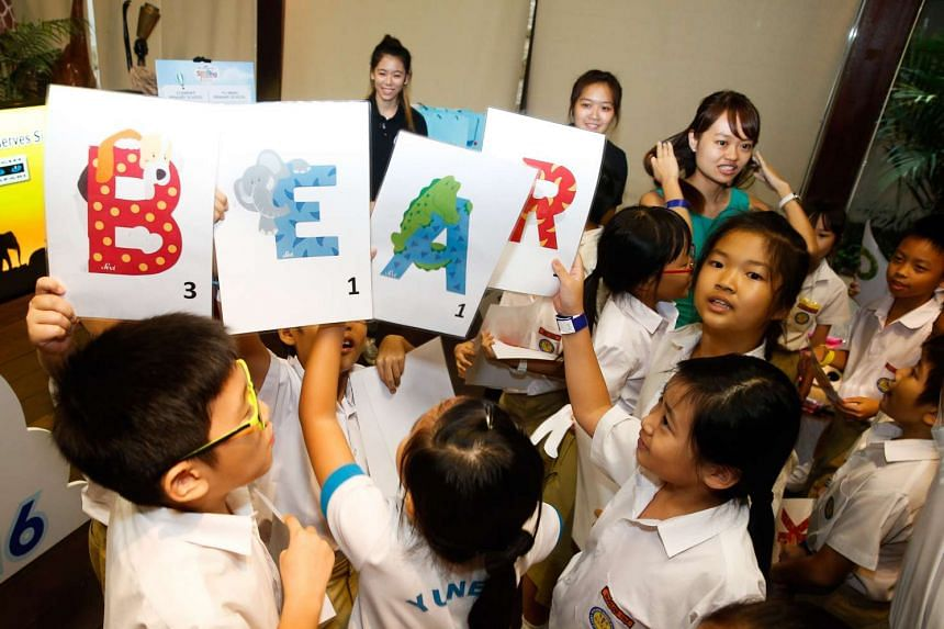"""Pupils from Yu Neng Primary facing off in a round of """"human Scrabble"""" at the Singapore Zoo on Jan 26, 2016."""
