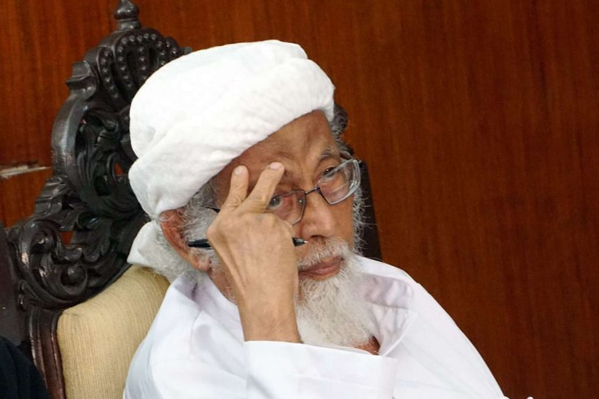Indonesian cleric Abu Bakar Bashir listening to the judge in court in Cilacap, Central Java, on Jan 26, 2016.