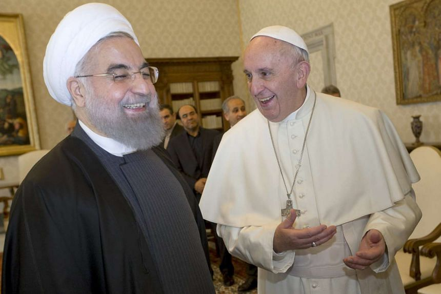 Iran President Hassan Rouhani (left) smiles with Pope Francis at the Vatican on Jan 26, 2016.