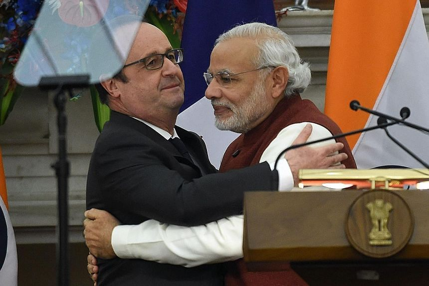 Mr Modi (right) and Mr Hollande after a press conference in New Delhi yesterday. The French President is in India as the chief guest at the country's Republic Day parade.